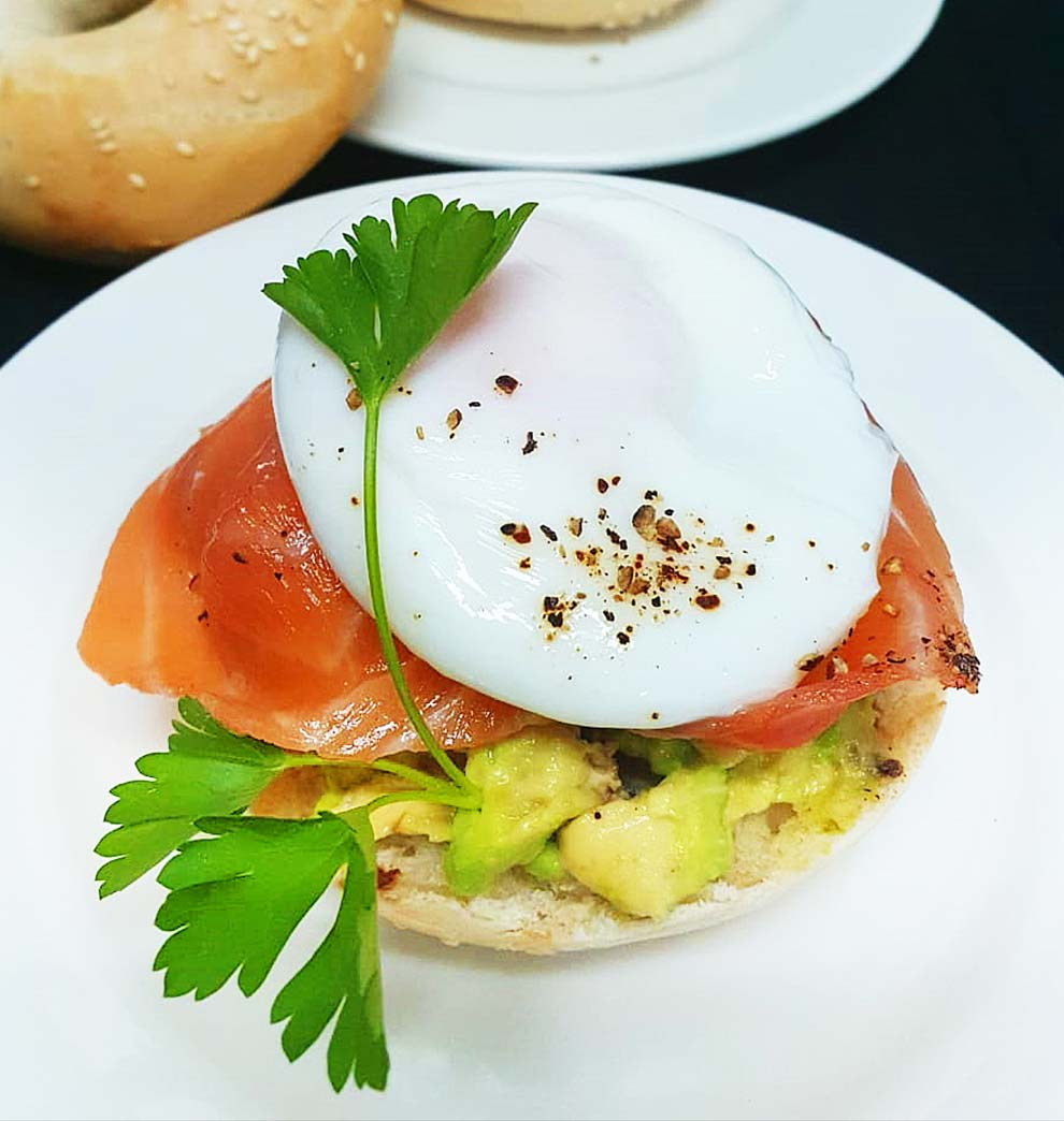 Poached Egg on Salmon with Crushed Avocado on Bagel